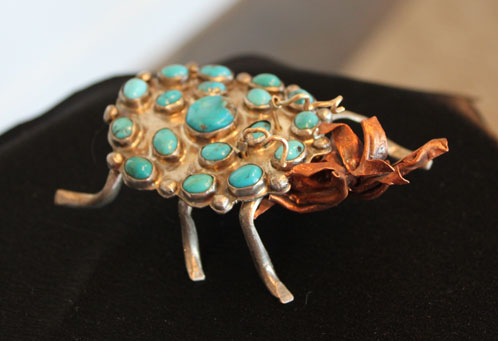 A fun sculptured brooch of silver, turquoise and copper.....a bug called the elusive french tickler